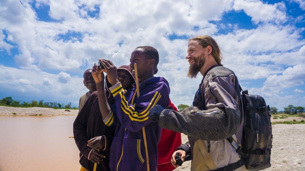 Some Masais showing us a Hippo